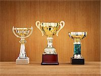 Trophies on wooden background Stock Photo - Premium Royalty-Freenull, Code: 6102-06336815