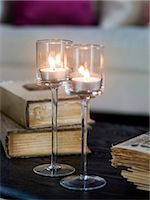 Close up of glass with tea lights on table Stock Photo - Premium Royalty-Freenull, Code: 6102-06336910