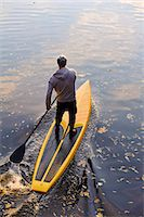 forward - Man rowing paddle board in water, elevated view Stock Photo - Premium Royalty-Freenull, Code: 6102-06336936