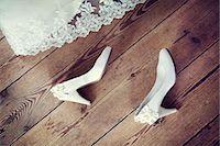 Wedding shoes on floor Stock Photo - Premium Royalty-Freenull, Code: 6102-06336966