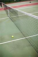 High angle view of net and tennis ball Stock Photo - Premium Royalty-Freenull, Code: 6102-06337034