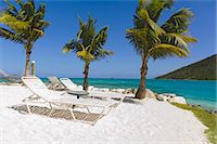 paradise (place of bliss) - Idyllic beach with empty lounge chair Stock Photo - Premium Royalty-Freenull, Code: 6102-06337125