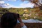 A tourist taking photo of Rokuon-ji Temple (Kinkakuji), Kyoto, Japan Stock Photo - Premium Rights-Managed, Artist: Oriental Touch, Code: 855-06338435