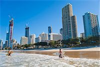 queensland - Surfers heading out to surf at Surfers Paradise beach, the Gold Coast, Queensland, Australia, Pacific Stock Photo - Premium Rights-Managednull, Code: 841-06341109