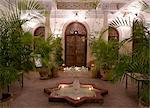An interior courtyard featuring a marble fountain and palm trees at the Villa des Orangiers in Marrakech, Morocco, North Africa, Africa Stock Photo - Premium Rights-Managed, Artist: Robert Harding Images, Code: 841-06341303