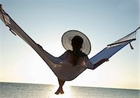 Woman on a hammock on the beach, Florida, United States of America, North America Stock Photo - Premium Rights-Managednull, Code: 841-06342818