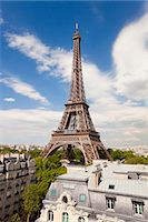 Eiffel Tower, viewed over rooftops, Paris, France, Europe Stock Photo - Premium Rights-Managednull, Code: 841-06343131