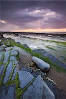 Stormy sunset over the Bristol Channel, viewed from the rocky shores of Kilve Beach, Somerset, England, United Kingdom, Europe Stock Photo - Premium Rights-Managednull, Code: 841-06343481