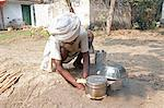 Bihari man in white turban and dhoti, making clay oven in the ground to cook his meal at Sonepur Cattle Fair, Bihar, India, Asia Stock Photo - Premium Rights-Managed, Artist: Robert Harding Images, Code: 841-06343883