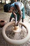 Village potter forming hand made clay pot on potter's wheel spinning in his village workshop, near Rayagada, Orissa, India, Asia Stock Photo - Premium Rights-Managed, Artist: Robert Harding Images, Code: 841-06343910