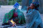 Jul'hoan !Kung Bushman, two women smoke around a fire in their village, Bushmanland, Kalahari Desert, Namibia, Africa Stock Photo - Premium Rights-Managed, Artist: Robert Harding Images, Code: 841-06344717