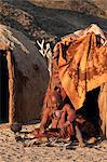 Himba woman sitting outside her hut, Purros village, northern Kaokoland, Namibia, Africa Stock Photo - Premium Rights-Managed, Artist: Robert Harding Images, Code: 841-06344741