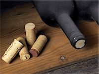 Wine bottles and corks in a cellar Stock Photo - Premium Royalty-Freenull, Code: 618-06346359