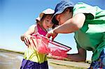 Children examining fishing nets Stock Photo - Premium Royalty-Free, Artist: Robert Harding Images, Code: 649-06352468