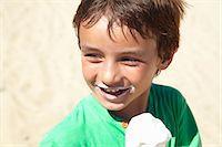 Boy eating ice cream on beach Stock Photo - Premium Royalty-Freenull, Code: 649-06352472