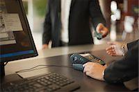 Businessman checking into hotel Stock Photo - Premium Royalty-Freenull, Code: 649-06352482
