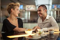 Smiling couple relaxing at bar Stock Photo - Premium Royalty-Freenull, Code: 649-06352511
