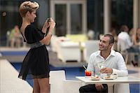 Woman taking picture of boyfriend Stock Photo - Premium Royalty-Freenull, Code: 649-06352519