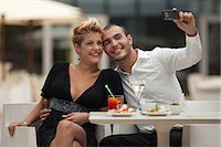 Couple taking picture of themselves Stock Photo - Premium Royalty-Freenull, Code: 649-06352520