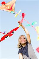 Girl playing with kite outdoors Stock Photo - Premium Royalty-Freenull, Code: 649-06352628