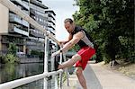 Runner stretching on city street Stock Photo - Premium Royalty-Free, Artist: Cultura RM, Code: 649-06352720