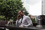 Businessman on cell phone at cafe Stock Photo - Premium Royalty-Free, Artist: Kathleen Finlay, Code: 649-06352745