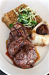 Plate of grilled beef with bone marrow Stock Photo - Premium Royalty-Free, Artist: James Tse, Code: 649-06352937