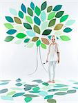 Girl standing under tree on wall Stock Photo - Premium Royalty-Free, Artist: Blend Images, Code: 649-06352954