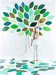 Girl painting tree on wall Stock Photo - Premium Royalty-Free, Artist: Jason Friend, Code: 649-06352955