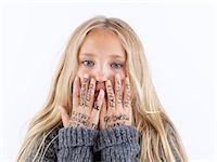 preteens fingering - Girl covering face with writing on hands Stock Photo - Premium Royalty-Freenull, Code: 649-06352968