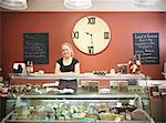 Grocer standing behind counter in shop Stock Photo - Premium Royalty-Free, Artist: Michael Mahovlich, Code: 649-06353036