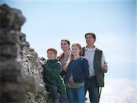 Farmer and family standing by stone wall Stock Photo - Premium Royalty-Freenull, Code: 649-06353049