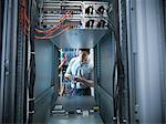 Man working in server room Stock Photo - Premium Royalty-Free, Artist: Blend Images, Code: 649-06353068