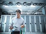Man working in server room Stock Photo - Premium Royalty-Free, Artist: Blend Images, Code: 649-06353075