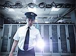 Security guard standing in server room Stock Photo - Premium Royalty-Free, Artist: Blend Images, Code: 649-06353077