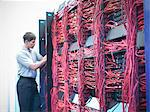 Man working in server room Stock Photo - Premium Royalty-Free, Artist: Blend Images, Code: 649-06353078