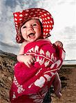 Infant laughing on beach Stock Photo - Premium Royalty-Free, Artist: ableimages, Code: 649-06353203