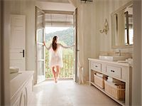 rich lifestyle - Woman standing at bathroom balcony Stock Photo - Premium Royalty-Freenull, Code: 649-06353228