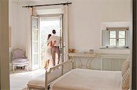 Couple admiring view from balcony Stock Photo - Premium Royalty-Freenull, Code: 649-06353244
