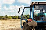 Farmer sitting in tractor in crop field Stock Photo - Premium Royalty-Free, Artist: R. Ian Lloyd, Code: 649-06353297