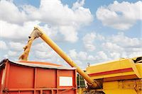 Grain elevator pouring into container Stock Photo - Premium Royalty-Freenull, Code: 649-06353306
