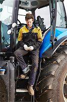 farm phone - Farmer using cell phone on tractor Stock Photo - Premium Royalty-Freenull, Code: 649-06353322