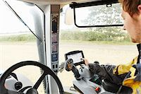 Farmer driving tractor in field Stock Photo - Premium Royalty-Freenull, Code: 649-06353332