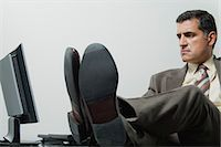 sole - Businessman sitting in office with feet up on desk Stock Photo - Premium Royalty-Freenull, Code: 632-06353969