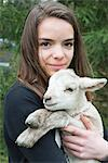 Teenage girl holding lamb Stock Photo - Premium Royalty-Free, Artist: Ben Seelt, Code: 633-06354767