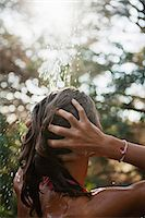 preteen shower pic - Girl washing hair under running water outdoors, rear view Stock Photo - Premium Royalty-Freenull, Code: 633-06355092