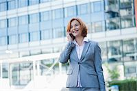 Businesswoman on Cellphone, Niederrad, Frankfurt, Germany Stock Photo - Premium Royalty-Freenull, Code: 600-06355225