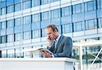 Businessman using Tablet PC, Niederrad, Frankfurt, Germany Stock Photo - Premium Royalty-Free, Artist: Uwe Umsttter, Code: 600-06355243