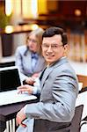 Businessman with a laptop at the table Stock Photo - Royalty-Free, Artist: Deklofenak                    , Code: 400-06355515