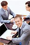 Businessman with a laptop at the table Stock Photo - Royalty-Free, Artist: Deklofenak                    , Code: 400-06355517
